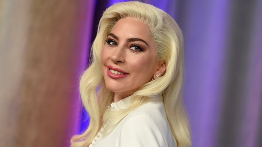 Lady Gaga has been 'communicating' with dog walker as she remains in Italy following shooting, her dad says
