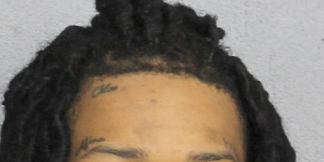 Cortlen Henry, 20, was arrested in connection with the shooting deaths.