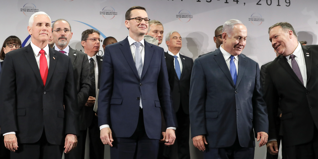 FILE - In this Thursday, Feb. 14, 2019 file photo, United States Vice President Mike Pence, Prime Minister of Poland Mateusz Morawiecki, Israeli Prime Minister Benjamin Netanyahu and United State Secretary of State Mike Pompeo, from left, stand on a podium at a conference on Peace and Security in the Middle East in Warsaw, Poland. A two-day security conference in Warsaw was supposed to be a crowning achievement for Israeli Prime Minister Benjamin Netanyahu, stamping a seal on his long-held goal of pushing his behind-the-scenes ties with Arab leaders into the open. Instead, the publicity-seeking Israeli leader made one embarrassing misstep after another, distracting attention from his main mission and sending his aides into a nonstop cycle of damage control. (AP Photo/Michael Sohn, File)
