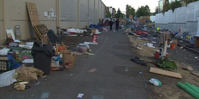 "Piles of debris awaited cleanup at an ""Occupy ICE"" camp in Portland, Oregon, after police cleared out protesters earlier this week. (KPTV-TV/FOX 12)"