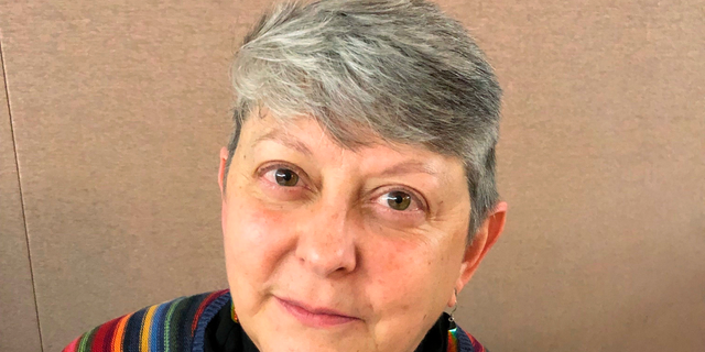 Lois McCullen Parr, 60, a United Methodist elder of Albion, Mich., poses for a picture at a national Methodist conference Monday, Feb. 25, 2019, in St. Louis. Nearly 900 delegates will decide whether America's second-largest Protestant denomination will fracture due to divisions over same-sex marriage and the ordination of LGBT clergy. Parr identifies as bisexual and queer and said no one should be left out of God's love. (AP Photo/Jim Salter)