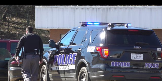 An Oxford police officer stops a motorist.