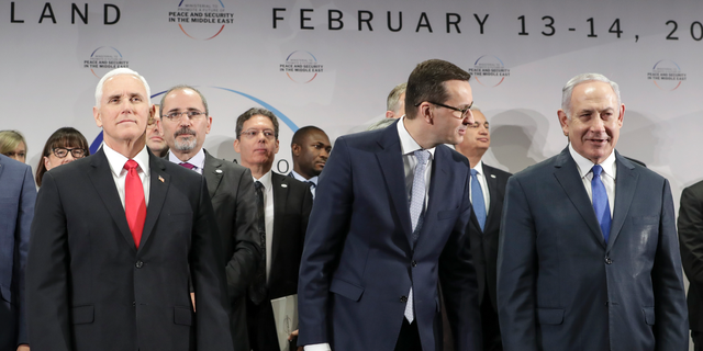United States Vice President Mike Pence, Prime Minister of Poland Mateusz Morawiecki and Israeli Prime Minister Benjamin Netanyahu, from left, stand on a podium at a conference on Peace and Security in the Middle East in Warsaw, Poland, Thursday, Feb. 14, 2019. The Polish capital is host for a two-day international conference, co-organized by Poland and the United States. (AP Photo/Michael Sohn)