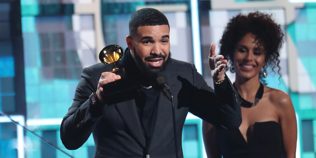 """Drake accepts the award for best rap song for """"God's Plan"""" at the 61st annual Grammy Awards on Sunday, Feb. 10, 2019, in Los Angeles."""