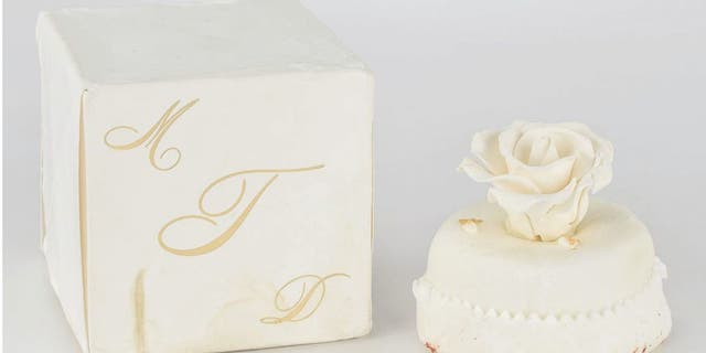 """The 14-year-old sweet for sale comes packaged in its original ivory box, stamped with a gold monogram """"MDT."""""""