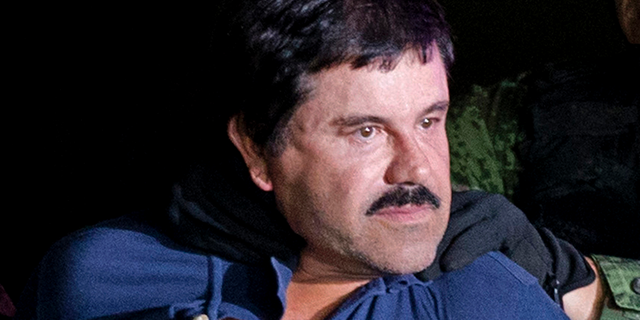 """Joaquin """"El Chapo"""" Guzman is made to face the media in Mexico City as he is escorted by Mexican soldiers following his recapture six months after escaping from a maximum security prison. The notorious Mexican drug lord was convicted of drug-trafficking charges, Tuesday, Feb. 12 2019, in federal court in New York. (AP Photo/Eduardo Verdugo, File)"""