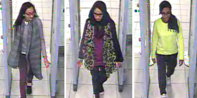 Metropolitan police released this image in 2015 of Kadiza Sultana, left, Shamima Begum, center, and Amira Abase going through security at Gatwick airport, south England, before catching their flight to Turkey.