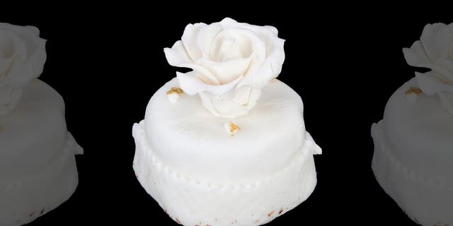 Another wedding cake favor from the Trump's 2005 nuptials (pictured here) – sold by Julien's Auctions – was expected to fetch the same sum when it went up for sale in November 2017.