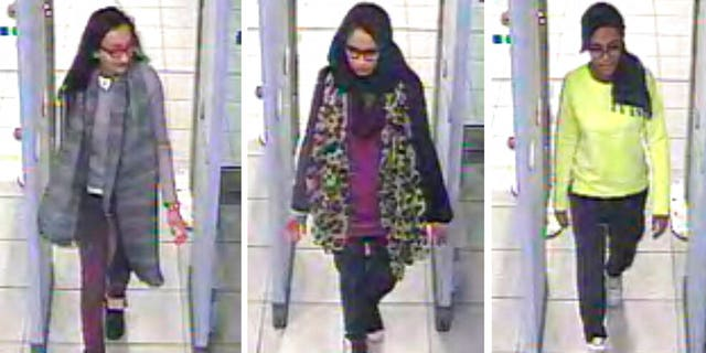 FILE - This Monday Feb. 23, 2015 file handout image of a three image combo of stills taken from CCTV issued by the Metropolitan Police shows Kadiza Sultana, left, Shamima Begum, center, and Amira Abase going through security at Gatwick airport, south England, before catching their flight to Turkey. Shamima Begum told The Times newspaper in a story published Thursday Feb. 14, 2019, that she wants to come back to London.
