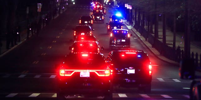 FILE- In this Jan. 30, 2018, file photo President Donald Trump's motorcade drives to the U.S. Capitol in Washington, where he will deliver his first State of the Union address. (AP Photo/Manuel Balce Ceneta, File)