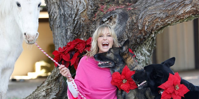 Bo Derek has always been passionate about animals — which explains why she was so excited to share the runway with Flynn.