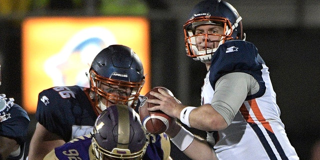 Orlando Apollos quarterback Garrett Gilbert, right, sets up to throw a pass in front of Atlanta Legends linebacker KeShun Freeman (92) during the first half of an Alliance of American Football game Saturday, Feb. 9, 2019, in Orlando, Fla. (Associated Press)