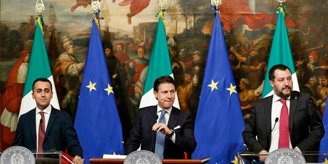 Italian Premier Giuseppe Conte, center, Deputy Premier and Labour and Industry Minister Luigi Di Maio, left, and Deputy Premier and Interior Minister, Matteo Salvini, attend a press conference following a Cabinet meeting at Chigi Palace's premier office in Rome, Thursday, Jan. 17, 2019.