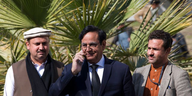 Saiful Malook, center, lawyer of Pakistani Christian woman Aasia Bibi who is facing blasphemy charges, arrives at the Supreme Court, in Islamabad, Pakistan, Tuesday, Jan. 29.