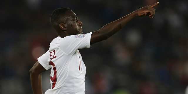 Qatar's forward Almoez Ali celebrates ahet he scored first goal during the AFC Asian Cup final match between Japan and Qatar in Zayed Sport City in Abu Dhabi, United Arab Emirates, Friday, Feb. 1, 2019. (AP Photo/Kamran Jebreili)