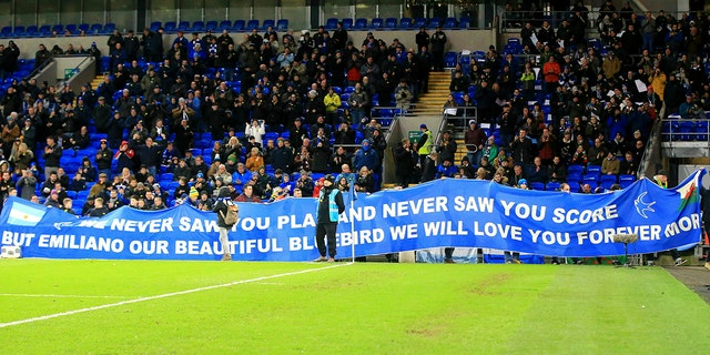 Tributes are paid to Emiliano Sala ahead of the English Premier League soccer match between Cardiff and Bournemouth at the Cardiff City Stadium, in Cardiff, Wales, Saturday, Feb. 2, 2019. (Mark Kerton/PA via AP)