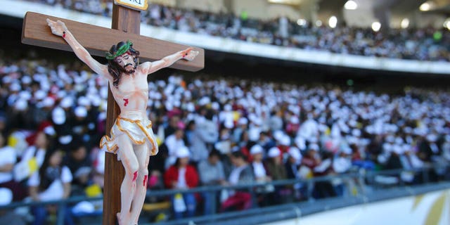 Worshippers attend Pope Francis Mass at the Sheikh Zayed Sports City in Abu Dhabi, United Arab Emirates.
