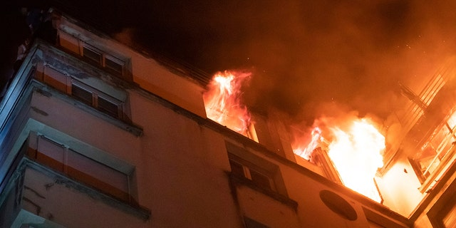 In this image provided on Tuesday, Feb. 5, 2019 by the Brigade de Sapeurs-Pompiers de Paris (Paris Fire Brigade) a fire rages through the top floors of an apartment building in Paris, France.