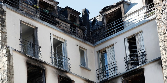 View of the apartment building after a fire broke Tuesday, Feb. 5, 2019 in Paris. Paris' deadliest fire in over a decade claimed 10 lives, sending fleeing residents to the roof to escape the flames that engulfed their apartment building before dawn Tuesday.