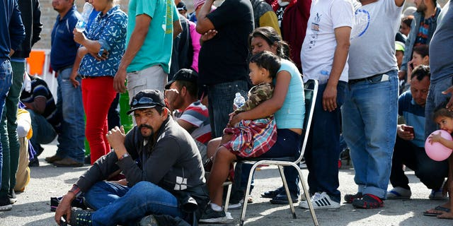 "Central American immigrants line up to register with Mexican Immigration officials at a shelter in Piedras Negras, Mexico, Tuesday, Feb. 5, 2019. A caravan of about 1,600 Central American migrants camped Tuesday in the Mexican border city of Piedras Negras, just west of Eagle Pass, Texas. The governor of the northern state of Coahuila described the migrants as ""asylum seekers,"" suggesting all had express intentions of surrendering to U.S. authorities. (Jerry Lara/The San Antonio Express-News via AP)"