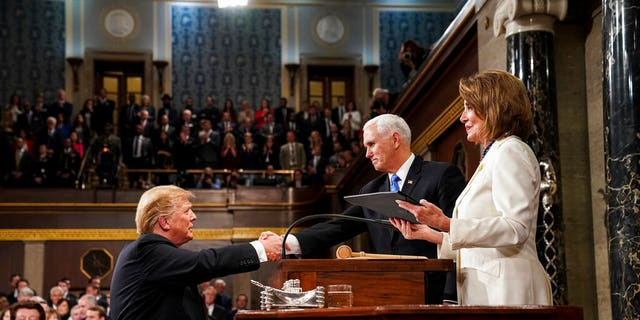 President Donald Trump shakes hands with Vice President Mike Pence, as House Speaker Nancy Pelosi looks on, as he arrives in the House chamber before giving his State of the Union address to a joint session of Congress, Tuesday, Feb. 5, 2019 at the Capitol in Washington. (Doug Mills/The New York Times via AP, Pool)
