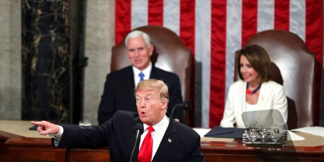 President Donald Trump acknowledges women in Congress as he delivers his State of the Union address to a joint session of Congress on Capitol Hill in Washington, as Vice President Mike Pence and Speaker of the House Nancy Pelosi, D-Calif., watch, Tuesday, Feb. 5, 2019. (AP Photo/Andrew Harnik)