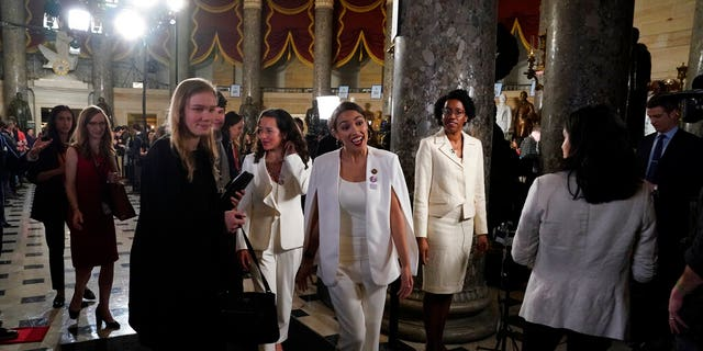 Rep. Alexandria Ocasio-Cortez, D-N.Y., right, walks with her guest Ana Maria Archila, before President Donald Trump delivers his State of the Union address to a joint session of Congress on Capitol Hill in Washington, Tuesday, Feb. 5, 2019. (AP Photo/Carolyn Kaster)