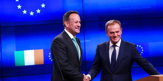 Irish Prime Minister Leo Varadkar, left, shakes hands with European Council President Donald Tusk after making a joint statement following their meeting at the Europa building in Brussels, Wednesday, Feb. 6.