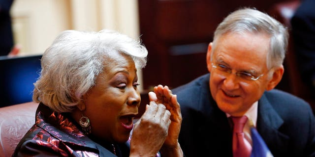Virginia's State Senate majority leader, Thomas Norment, R-James City County, shares a laugh with Sen. Louise Lucas, D-Portsmouth, during a Senate session in Richmond on Thursday. (AP Photo/Steve Helber)