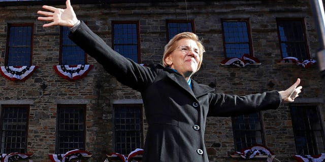 Sen. Elizabeth Warren, D-Mass., acknowledges cheers as she takes the stage during an event to formally launch her presidential campaign, Saturday, Feb. 9, 2019, in Lawrence, Mass. (AP Photo/Elise Amendola)