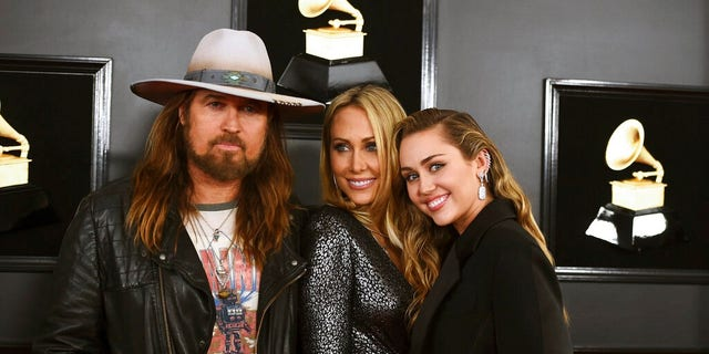 Billy Ray Cyrus, from left, Tish Cyrus, and Miley Cyrus arrive at the 61st annual Grammy Awards.