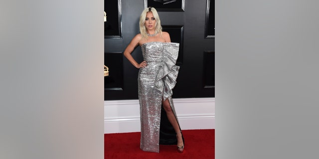Lady Gaga dazzles in a silver sequin dress.