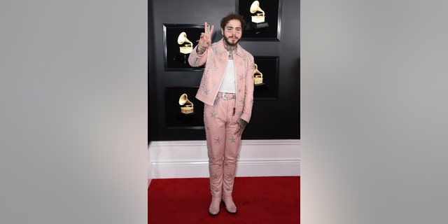 Post Malone arrives at the 61st annual Grammy Awards at the Staples Center on Sunday, Feb. 10, 2019, in Los Angeles.