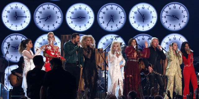 "Maren Morris, from left, Katy Perry, Jimi Westbrook, Kimberly Schlapman, Dolly Parton, Karen Fairchild, Philip Sweet, Miley Cyrus and Kacey Musgraves perform ""9 to 5"" at the 61st annual Grammy Awards on Sunday, Feb. 10, 2019, in Los Angeles."