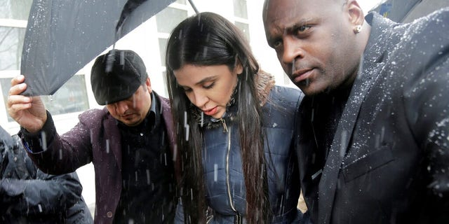 """Emma Coronel Aispuro, center, wife of Joaquin """"El Chapo"""" Guzman, arrive at the courthouse on Tuesday."""