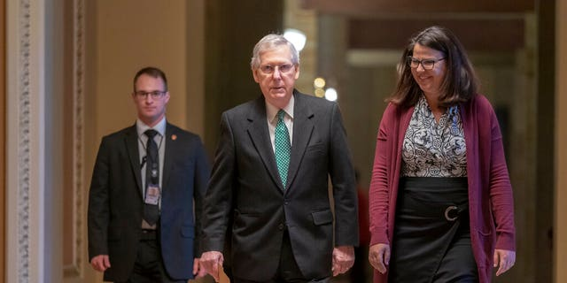 Senate Majority Leader Mitch McConnell, R-Ky. , walks to the chamber on the morning after House and Senate negotiators worked out a border security compromise hoping to avoid another government shutdown, at the Capitol in in Washington, Tuesday, Feb. 12, 2019.