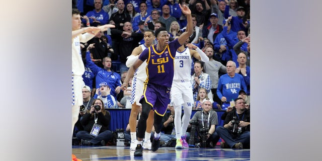 LSU's Kavell Bigby-Williams (11) celebrates after tipping in the game winning shot against Kentucky after an NCAA college basketball game in Lexington, Ky., Tuesday, Feb. 12, 2019. LSU won 73-71. (AP Photo/James Crisp)