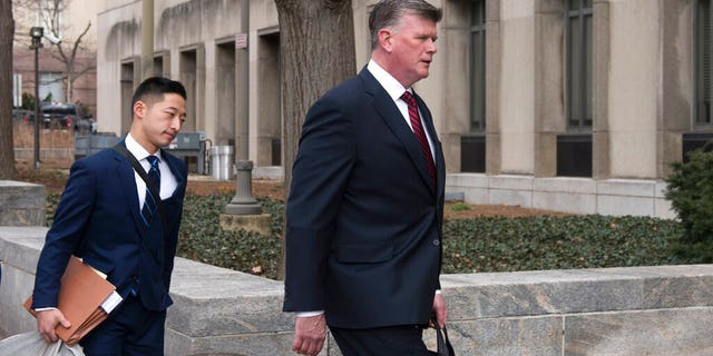 Kevin Downing, Paul Manafort's defense attorney, right, walks to the entrance of federal court on Wednesday, Feb. 13, 2019 in Washington. At left is attorney Tim Wang, another member of the defense team for Manafort. (AP Photo/Kevin Wolf)