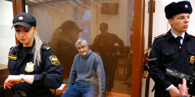 Founder of the Baring Vostok investment fund Michael Calvey sits in a cage in the courtroom in Moscow, Russia, Friday, Feb. 15, 2019.