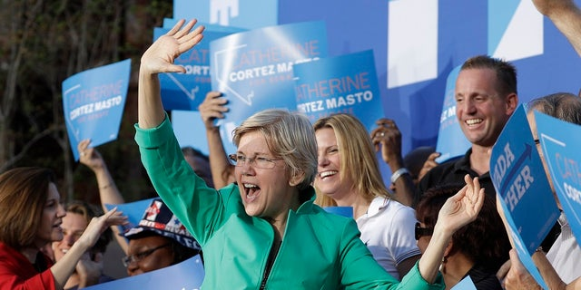 FILE - Sen. Elizabeth Warren, D-Mass., was briefly heckled during a campaign rally in Georgia over her Native American ancestry claims. (AP Photo/John Locher, File)