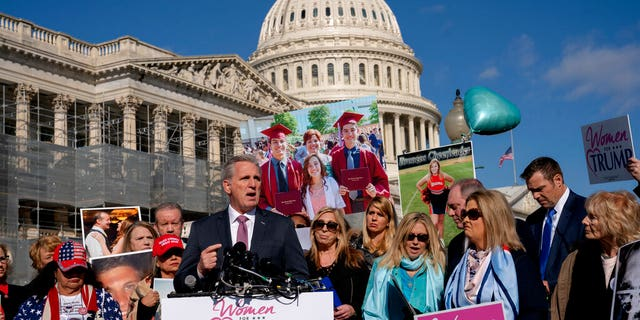 In this Feb. 13, 2018, photo, House Minority Leader Kevin McCarthy, R-Calif., joins supporters of President Donald Trump and family members of Americans killed by undocumented immigrants as they gather to to promote their support for a border wall with Mexico, at the Capitol in Washington. When you want results in a polarized Washington, sometimes it pays to simply leave the professionals alone to do their jobs. (AP Photo/J. Scott Applewhite)
