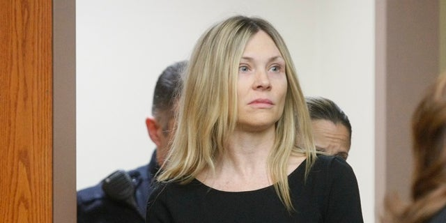 FILE: Amy Locane Bovenizer enters the courtroom to be sentenced in Somerville, N.J.,Feb. 14, 2013, for the 2010 drunk driving accident in Montgomery Township that killed 60-year-old Helene Seeman. (Associated Press)