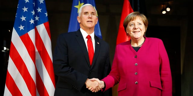 Vice President Mike Pence and German Chancellor Angela Merkel meet atthe Munich Security Conference in Munich, Germany, Feb. 16, 2019. (Associated Press)