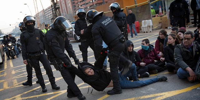 Violent clashes between Catalan riot police and pro-independence protesters in Barcelona