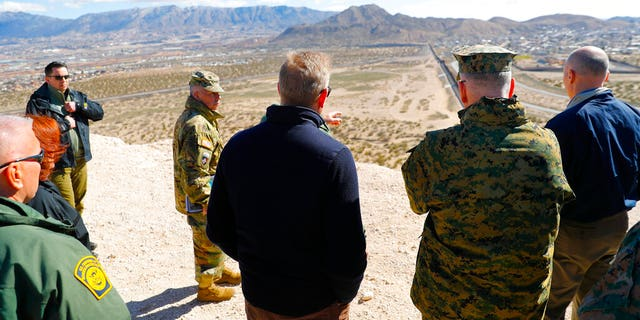 Acting Secretary of Defense Patrick Shanahan, center, and Joint Chiefs Chairman Gen. Joseph Dunford, second from the right, during a tour of the U.S.-Mexico border at Santa Teresa Station in Sunland Park, N.M., on Saturday. (AP Photo/Pablo Martinez Monsivais)