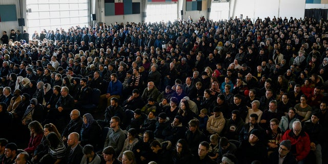 Family members, friends and members of the community attend the funeral for the seven Syrian refugee Barho siblings in Halifax, Nova Scotia, Saturday, Feb. 23, 2019. The siblings, who died in a house fire earlier in the week, are survived by their parents. (Darren Calabrese/The Canadian Press via AP)