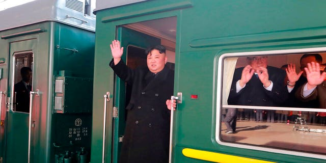 """In this Saturday, Feb. 23, 2019, photo provided on Sunday, Feb. 24, 2019, by the North Korean government, North Korean leader Kim Jong Un waves from a train before leaving Pyongyang Station, North Korea, for Vietnam. Kim was on a train Sunday to Vietnam for his second summit with U.S. President Donald Trump, state media confirmed. Independent journalists were not given access to cover the event depicted in this image distributed by the North Korean government. The content of this image is as provided and cannot be independently verified. Korean language watermark on image as provided by source reads: """"KCNA"""" which is the abbreviation for Korean Central News Agency. (Korean Central News Agency/Korea News Service via AP)"""