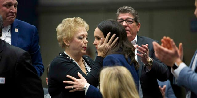Jessica Patterson, right, shares a moment with her mother Julie Millan, after being nominated for chair of California Republican Party during their convention in Sacramento, Calif., Saturday, Feb. 23, 2019. (AP Photo/Steve Yeater)