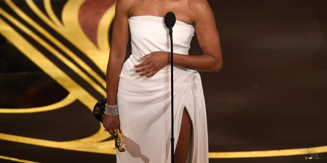 "Regina King accepts the award for best performance by an actress in a supporting role for ""If Beale Street Could Talk"" at the Oscars on Sunday, Feb. 24, 2019, at the Dolby Theatre in Los Angeles. (Photo by Chris Pizzello/Invision/AP)"