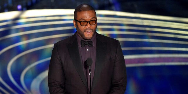 Tyler Perry presents the award for best cinematography at the Oscars.